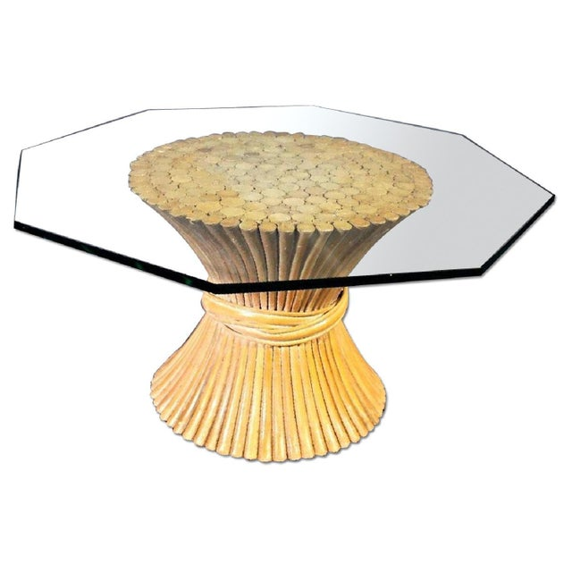 On offer on this occasion is an elegant McGUIRE corseted wheat coffee table with top quality, thick glass octagonal top....