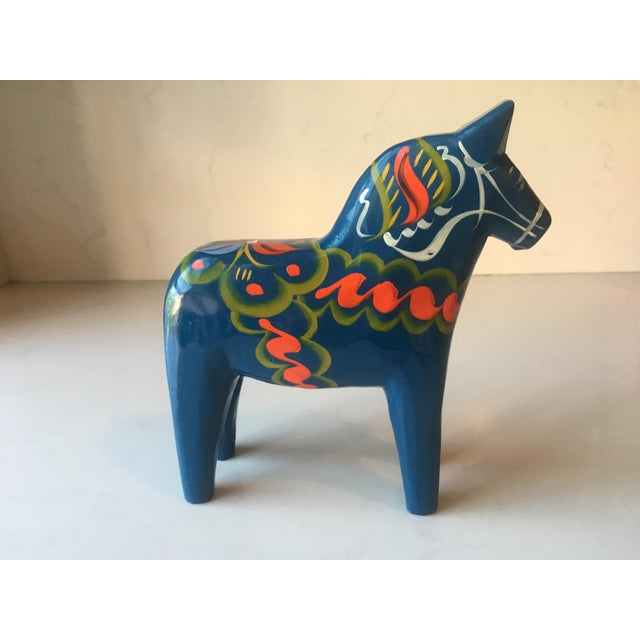 Vintage Nils Olsson Swedish Dala Horses in dark blue. Excellent condition. Carved wood fold art with official fabric label...