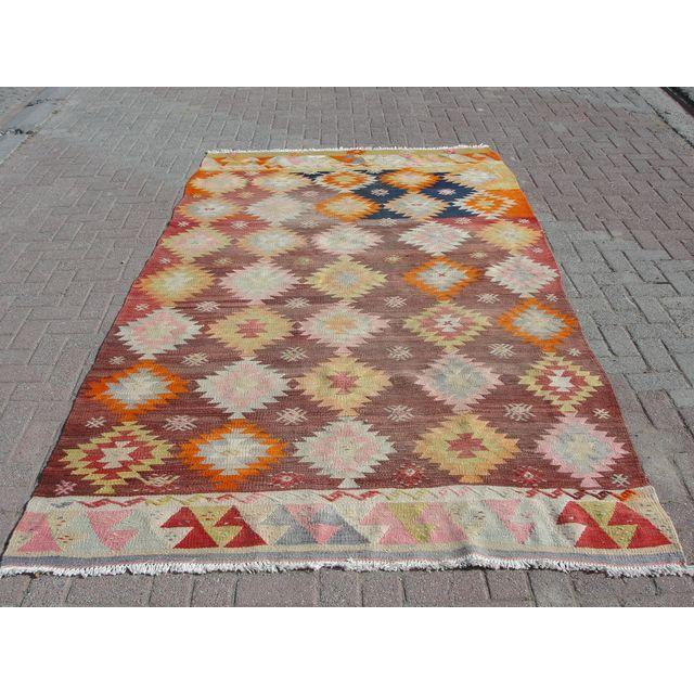 Vintage, handwoven Turkish Kilim rug. The kilim is nearly 60 years old. It is handmade of very fine quality natural wool...