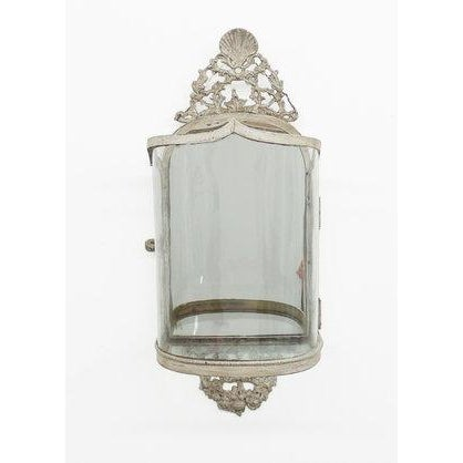 A Queen Anne style wall lantern executed in brass with a handcrafted slumped glass shade and mirror back. Candelabra shown...