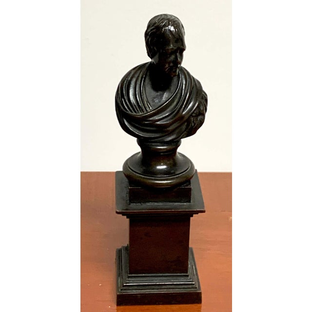 """19th century Regency bronze bust of Lord Byron, diminutive in size, portrait in later life. Measures: 1.75"""" square, 6.5""""..."""