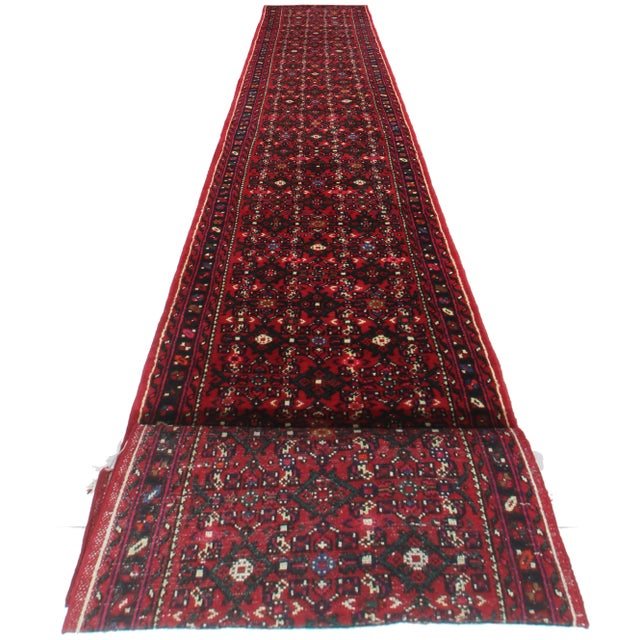 Here is a vintage Persian Hamedan runner rug. Hand-knotted from wool. Features a lovely design and rich, bold colors.