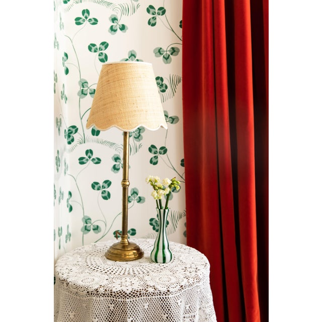 Our Raffia lampshade with scalloped trim is our signature design within our lighting collection. The scalloped edges came...