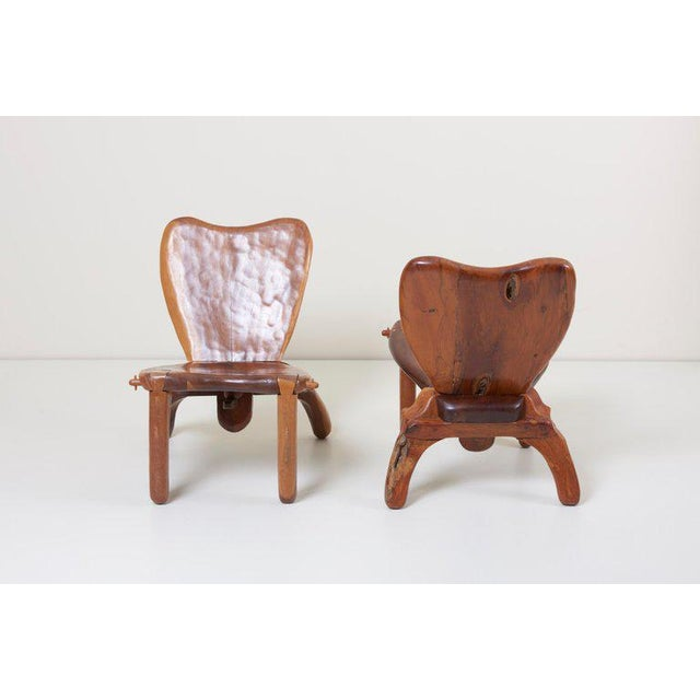 Highly sculptural studio crafted solid wood chairs by American-Mexican woodworker Don Shoemaker. Signed! The chair has...