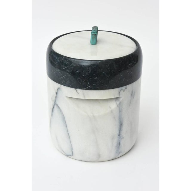 This vintage Mid-Century fabulous sculptural two part ice bucket is variegated marble with a patinaed bronze sculptural...