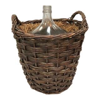 Large Vintage Demijohn Bottle in Handled Basket For Sale