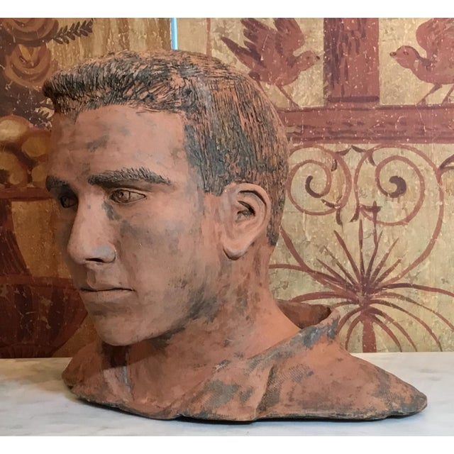 Intriguing bust of a young man made of rustic unglazed ceramic ,great eyes expression ,looking forward,exceptional object...