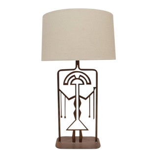 Rust Finished Metal Lamp with Symbolic Figure