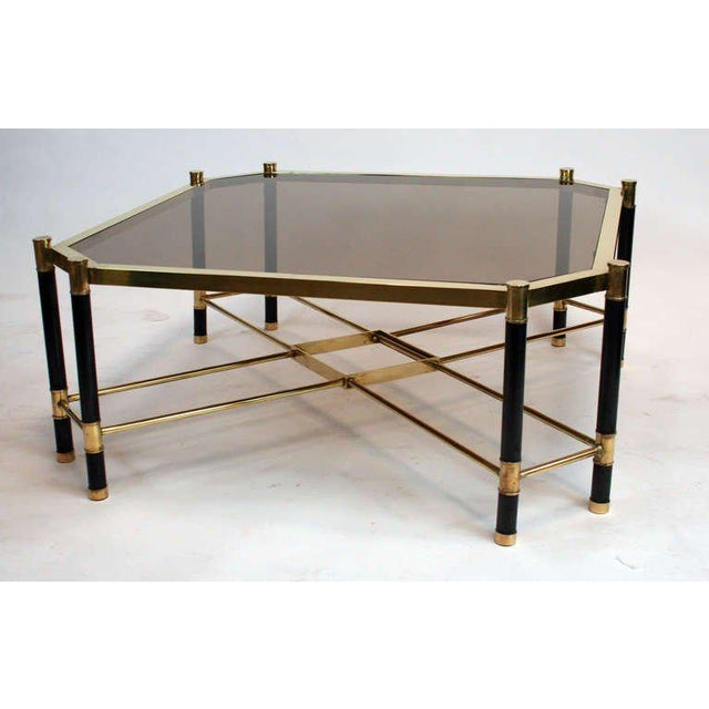"Chic 1970's French cocktail table with smoked bronze glass top on painted metal and brass frame. Chamfered corners and ""X""..."