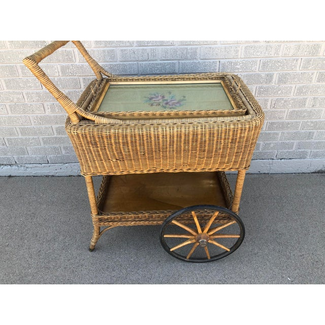 Antique, possibly 1920s, wicker rattan beverage cart with ample storage and a removable serving tray. Light brown,...