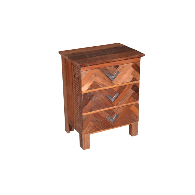 An understated design pairs with a natural finish to round out this bedside table. This collection is crafted of recycle...