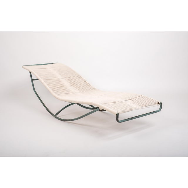 A pair of bronze rocking lounge chairs designed by Walter Lamb and produced by Brown Jordan. The design, referred to as...