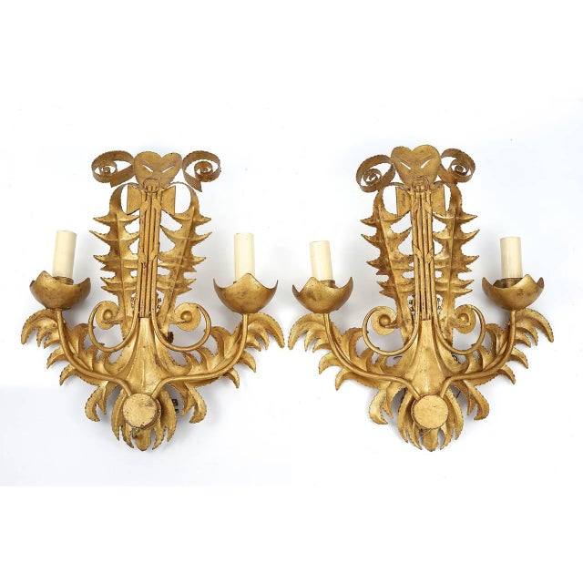 Pair of beautifully hand-forged metal, two arm wall sconces with stylized acanthus leaves, arrow quiver with crossbanding,...