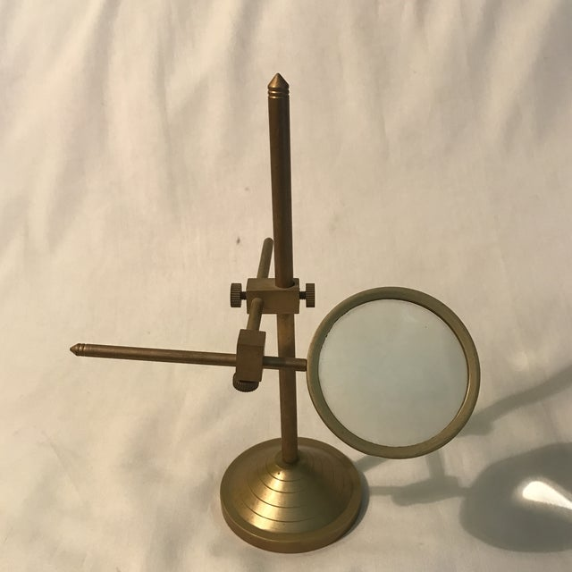 Vintage magnifying glass with adjustable brass stand, this especially rare magnifying glass tilts on axis as well as...