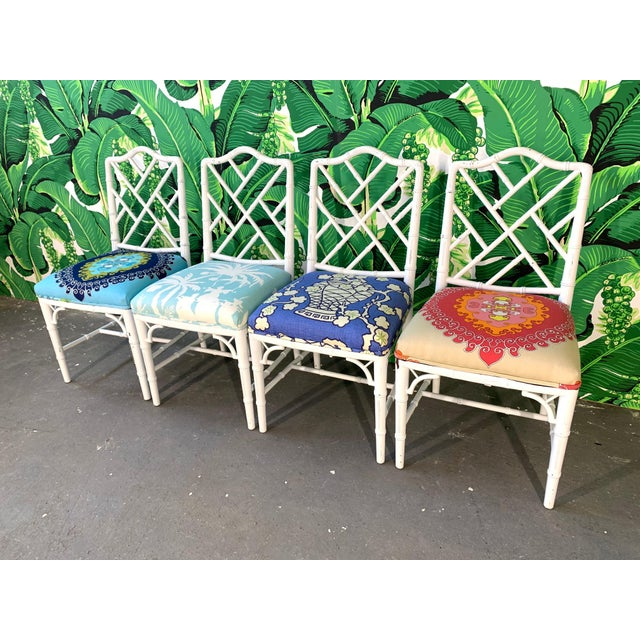 Set of four faux bamboo dining chairs in Chinese chippendale style. Perfect touch of chinoiserie in any decor. Cheery...