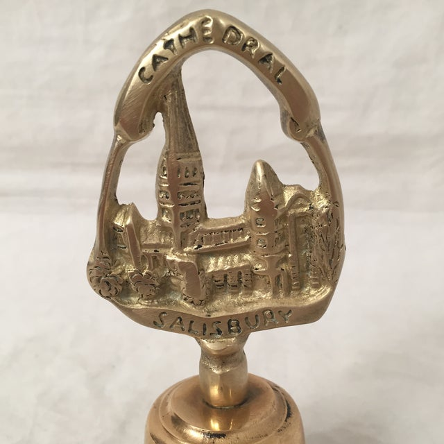 Vintage English Salisbury Cathedral brass bell likely dates circa early twentieth century. Handle features famed Salisbury...