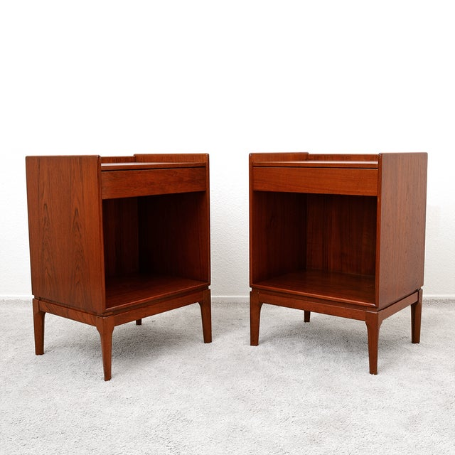 This pair of Mid Century Danish Teak nightstands has THE MOST amazing patina... just look at the color of that teak! These...