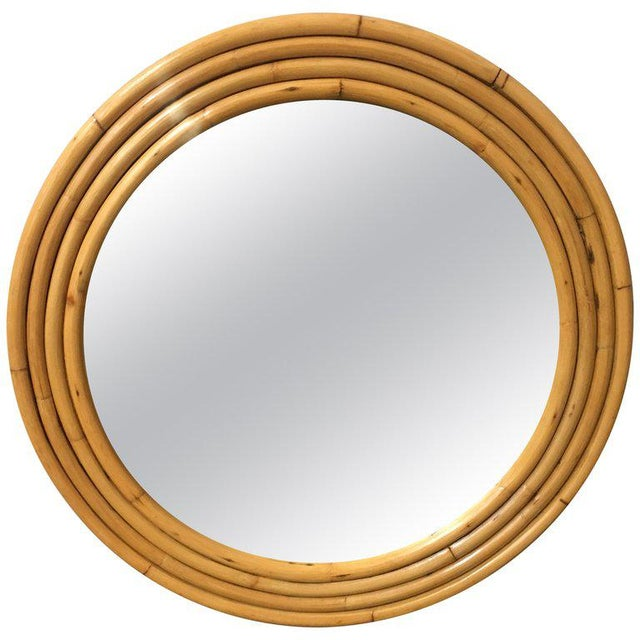 """38"""" round mirror featuring a four-stand rattan frame, circa 1940. Refinished to new for you. All rattan, bamboo and wicker..."""