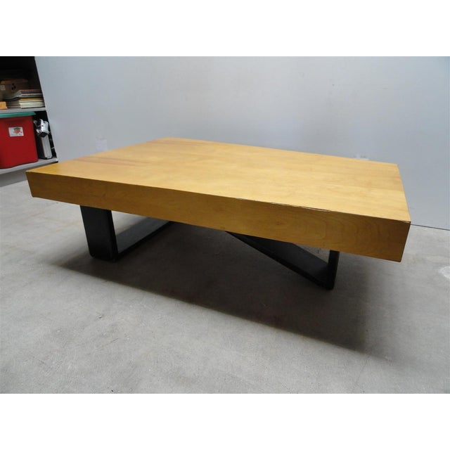 Rare and unique Barzilay Cocktail Table in Birch with Black painted Sculptural Legs. Birch top has a trapezoid form and...