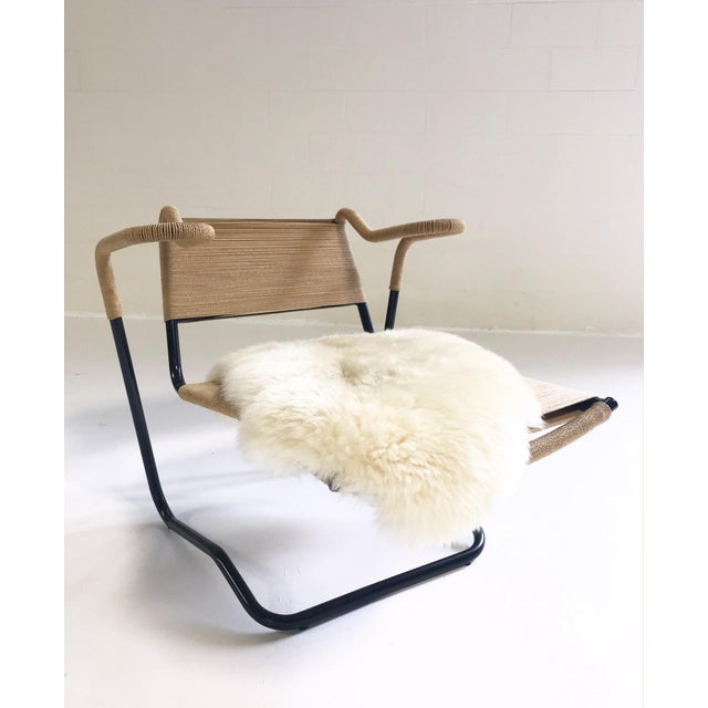 The natural materials, the interesting shape. We LOVE this chair. We added a soft Brazilian sheepskin to the seat for...