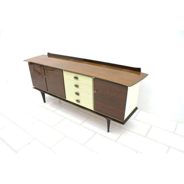 Mahogany sideboard with brass details and white lacquered parts. Beautiful details, Germany, circa 1950s. Good original...