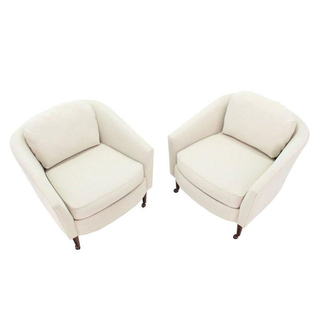 Pair of newly upholstered Mid-Century Modern barrel back chairs on oiled walnut legs.