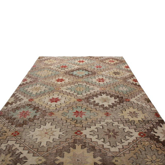 Hand-knotted in Turkey originating between 1950-1960, this vintage mid-century runner is the latest to join Rug & Kilim's...