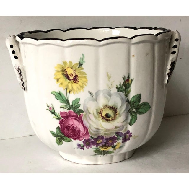 Beautifully fluted Italian porcelain cachepot with scalloped black upper rim. Hand painted with lovely floral motif all...