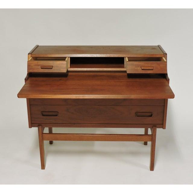 Practical and elegant teak secretary desk designed by Arne Wahl Iversen and made in Denmark by Vinde Mobelfabrik. This...