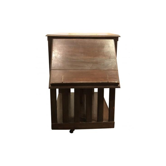 This is a great antique swivel bookcase and on casters. It also has a display shelf that can be brought out. as shown in...