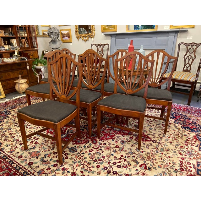 This is a beautiful set of antique chairs. There are 8 antique mahogany Irving and Casson dining chairs with satin band...