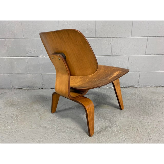Excellent pre-1957 example of Charles Eames' LCW chair. Given the rich wood patina, construction configuration and...
