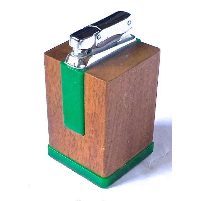 Mid-Century Modern wood and bakelite cigarette lighter. Green bakelite accents on walnut body. Chrome ignitor and handle....