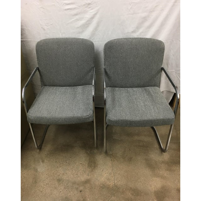 Newly upholstered in grey fabric with chrome arm rest and legs. They are both in excellent condition! seat height 18""