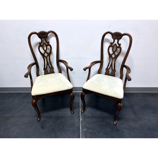Pair of captain's arm chairs by Thomasville. Made in North Carolina, USA circa 1980s. Solid Cherry wood. Queen Anne Style...