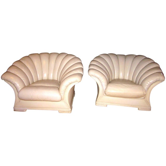 This is an exquisite pair of French Art Deco channeled scalloped back shell-shaped leather lounge, parlor, or boudoir...