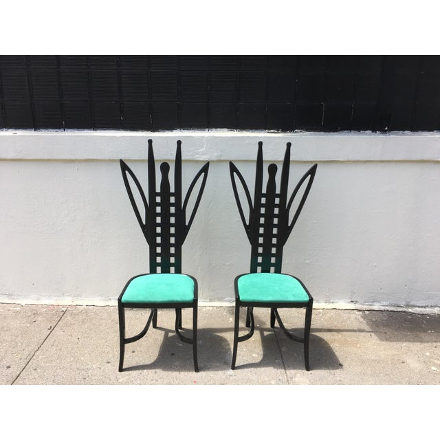 Whimsical and very rare , these black satin lacquer Italian Memphis side/ dining chairs feature what looks like a...