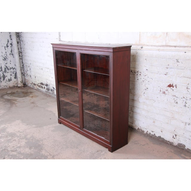 A gorgeous antique mahogany glass front double bookcase USA, Circa 1900 Shelves are adjustable. Doors lock, and key is...