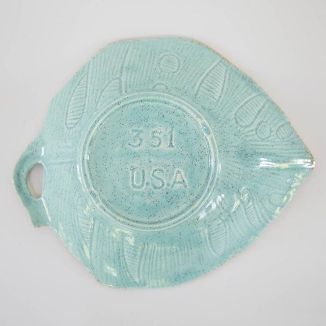 """Beautiful vintage USA pottery Monstera leaf dish with gold detailing. 8""""W x 7""""D x 2.5""""H."""