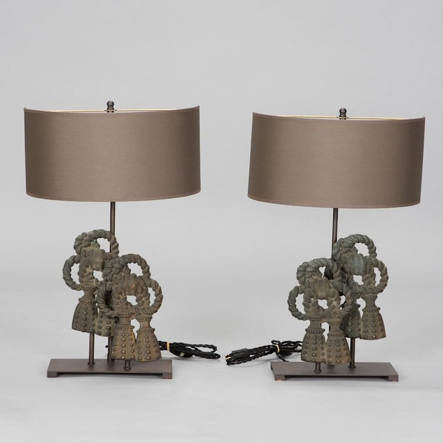 Each of these Belgian crafted lamps features an iron base with a double bow and tasseled ends, two lights, and a hand made...