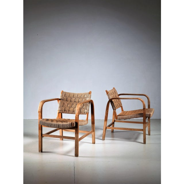 A pair of armchairs attributed to Danish architect and designer Magnus Stephensen for Fritz Hansen. They are made of a...