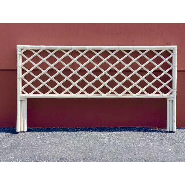 Beautiful king size bamboo headboard. Done in a cross hatch pattern with wrapped edges. Headboard only. Acquired from a...