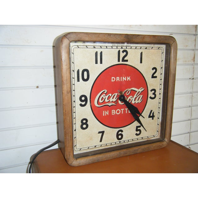 A vintage, 1939, square form, wood framed, glass front, electric Coca Cola advertising wall clock by Selecto in great,...