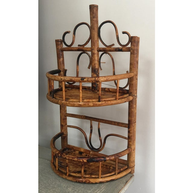 Fabulous vintage burnt or scorched bamboo wall shelf. The shelf has a wire for hanging. It can be used free-standing, but...