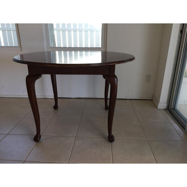 This incredibly solid sturdy table was formerly a display table In an exclusive men's department. The legs are dainty and...