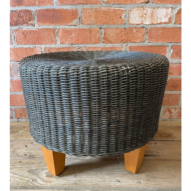 Great looking woven rattan and wicker round ottoman having 4 tapered light wood legs. Perfect for a stylish beach house....