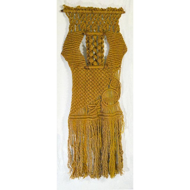 Macrame wall hanging, hand made in America. The patterns are changing patterns and designs that weave a path that has some...