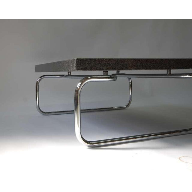 Tubular chrome frame coffee / cocktail or side table with 2 in. thick. square black granite top designed by Michael...