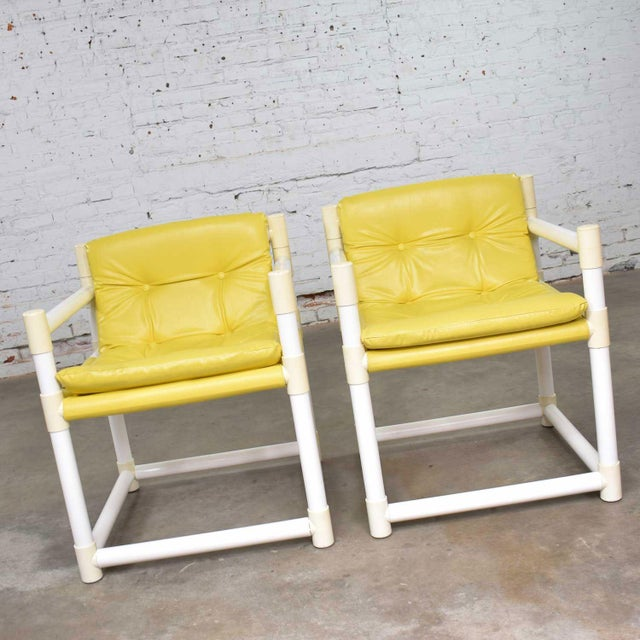 Fun pair of MCM mid-century modern white PVC side chairs with a yellow vinyl upholstery by Decorion Fun Furnishings of...