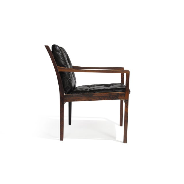 Mid-Century Brazilian Rosewood lounge chairs attributed to Ole Wanscher. Each lounge chair crafted of rich dynamic grained...